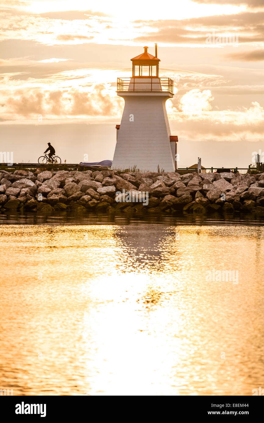 Backlit Lighthouse in Gaspe Peninsula, New Richmond, Quebec, Canada - Stock Image