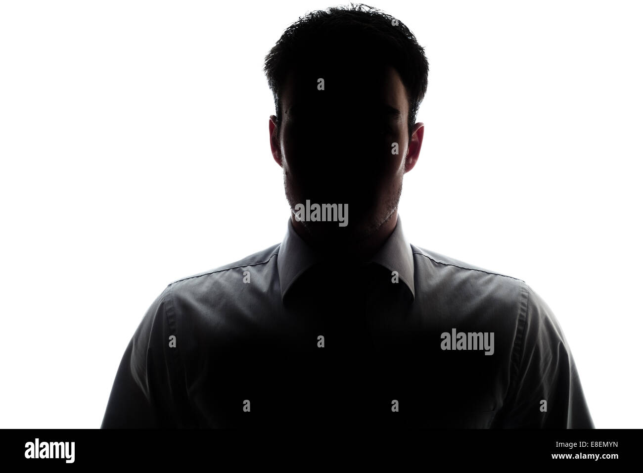 Businessman portrait silhouette and a misterious face - Stock Image