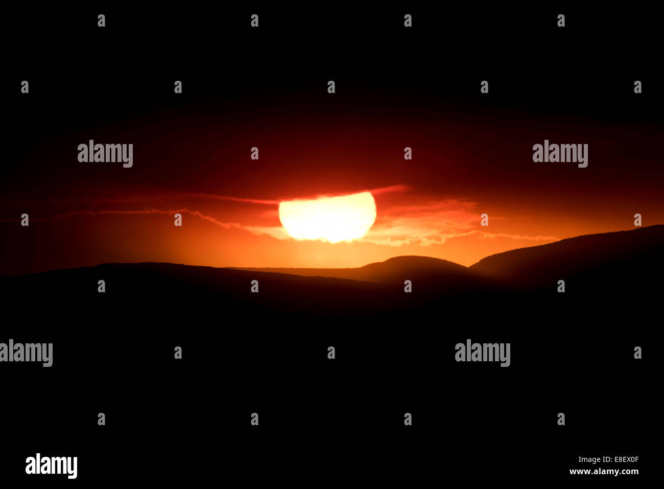 Sunset behind the ash and gas cloud of the Holuhraun fissure eruption, near the volcano Bárðarbunga, highlands - Stock Image