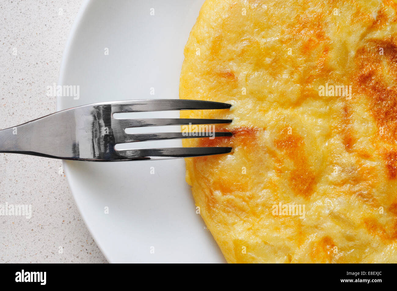 closeup of a plate with a typical tortilla de patatas, spanish omelet - Stock Image