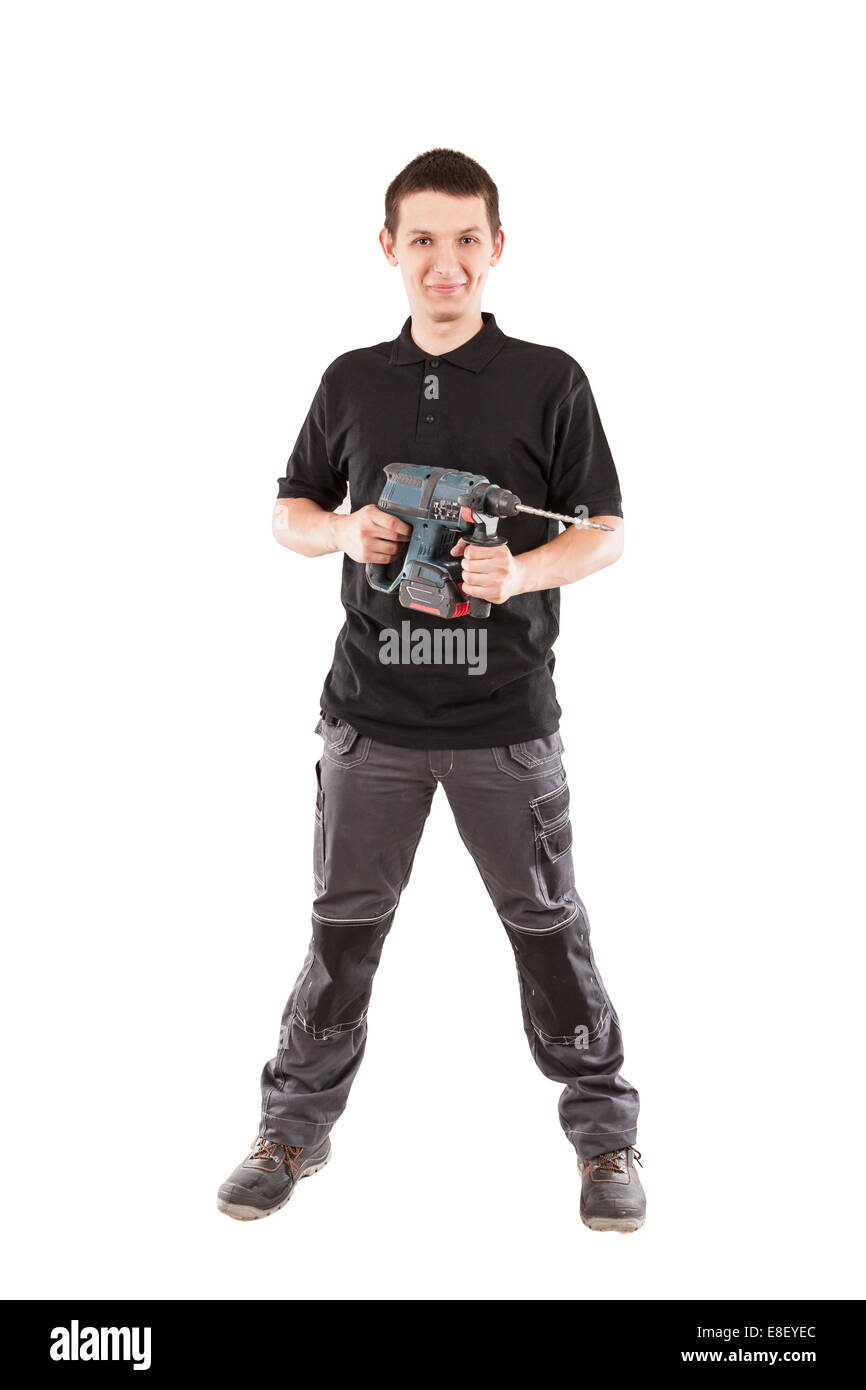 Male serviceman with hammer drill. - Stock Image