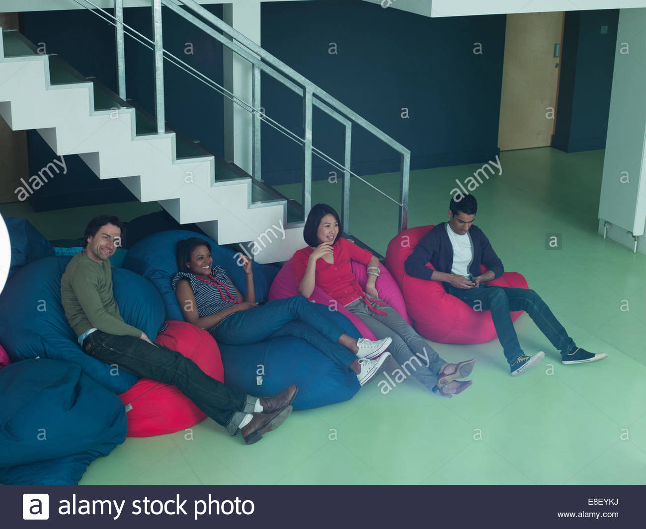 Business people in bean bag chairs - Stock Image