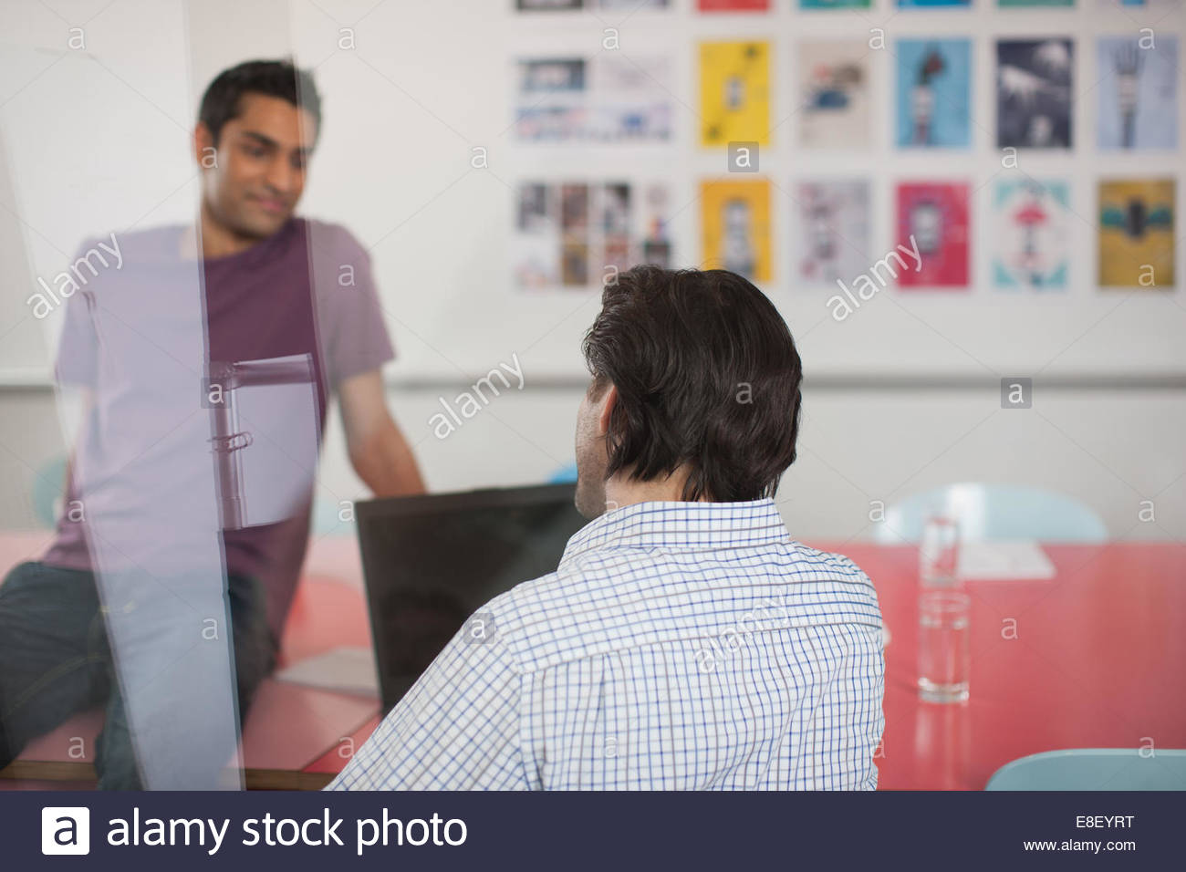 Men talking in meeting - Stock Image