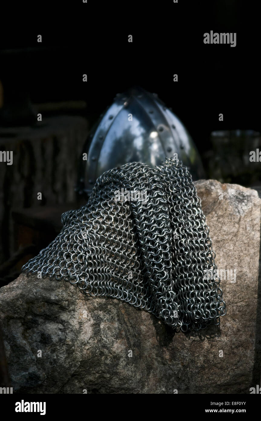 Coat of mail and helmet - Stock Image