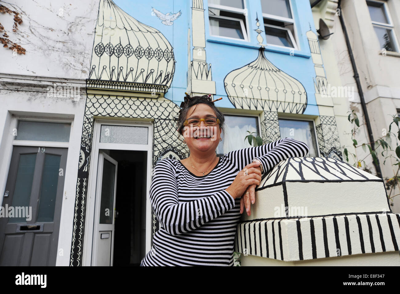 Brighton UK 3 October 2014 - Artist Kaye Teale  brightened up her house in Brighton by painting a mural of Royal Stock Photo