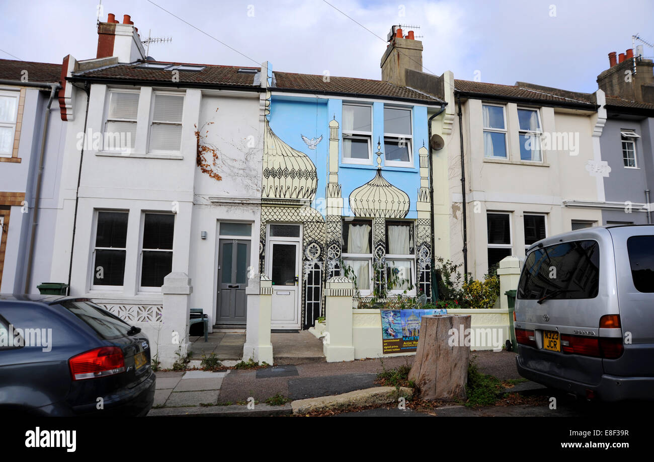 Brighton UK 3 October 2014 - Artist Kaye Teale  brightened up her house in Brighton by painting a mural of Royal - Stock Image
