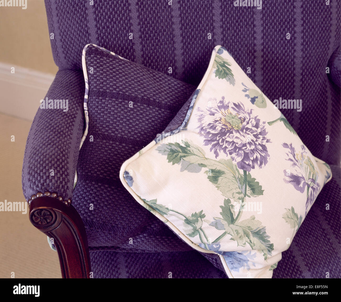 Close Up Of Floral Cushion On Purple Velvet Armchair