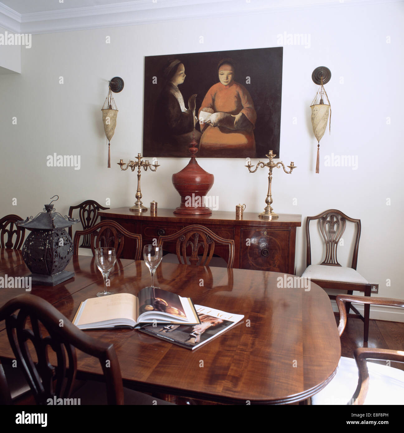 Regency Style Chairs And Table In White Dining Room With Large Picture  Above Sideboard With Brass Candelabra