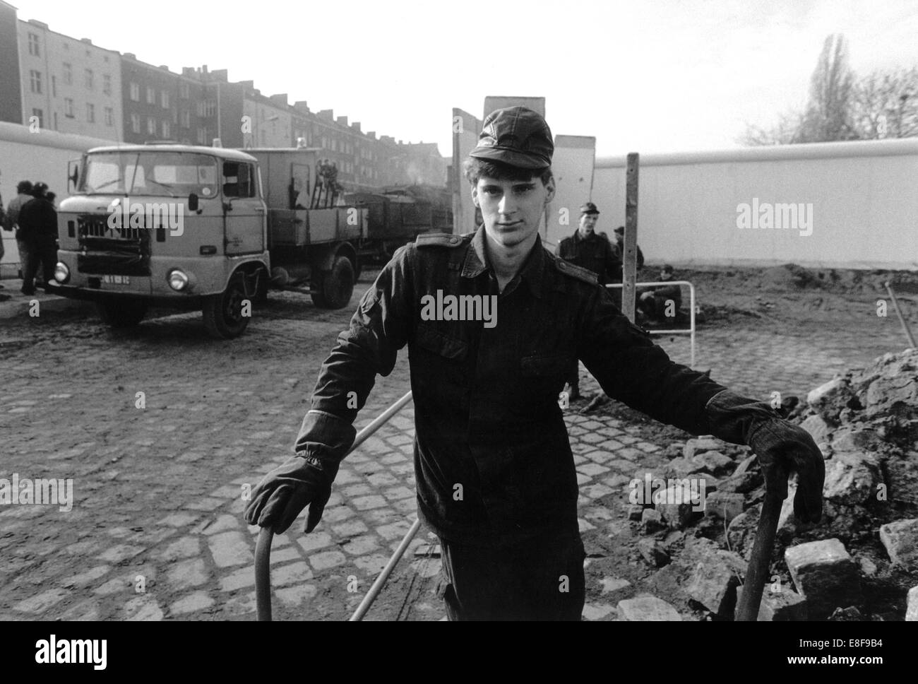 A former GDR border officer poses at a provisional border crossing at Eberswalder Street, opened to enable East - Stock Image
