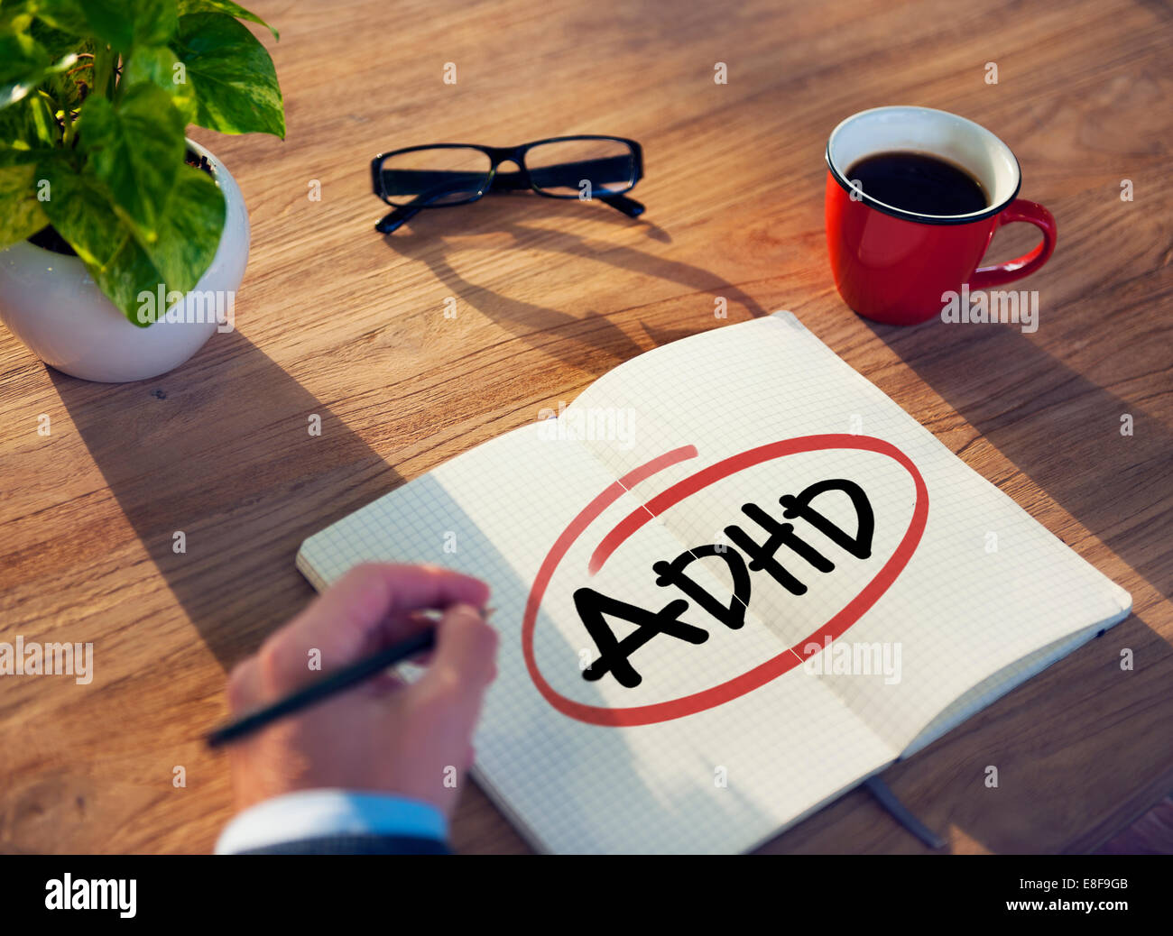 Hand with a Note and a Single Word ADHD - Stock Image