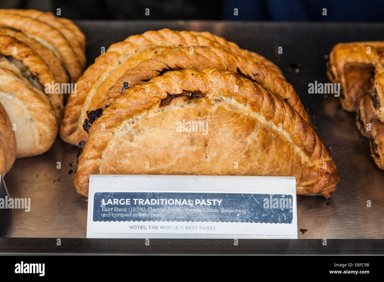 Picture of a Cornish pasties / pasty in the display of a pasty shop. Mevagissey, Cornwall. UK. - Stock Image