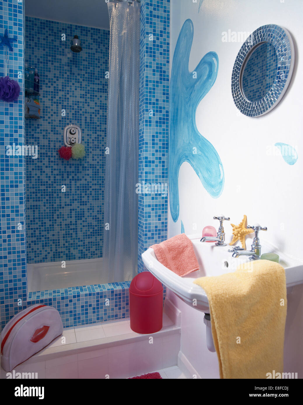 Blue mosaic tiling on shower in bathroom with hand-painted blue ...
