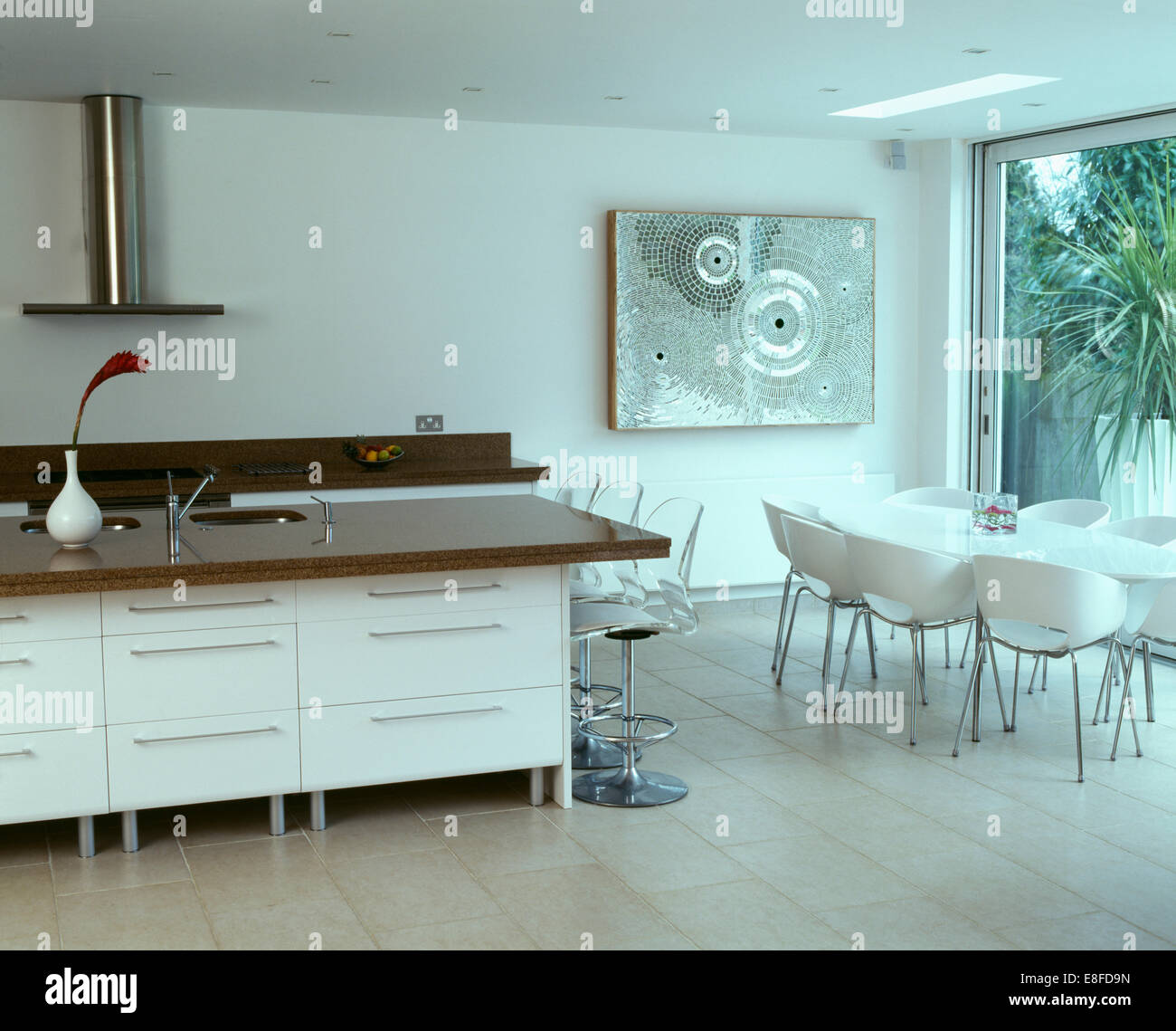 Perspex stools at breakfast bar in large modern kitchen with mosaic ...