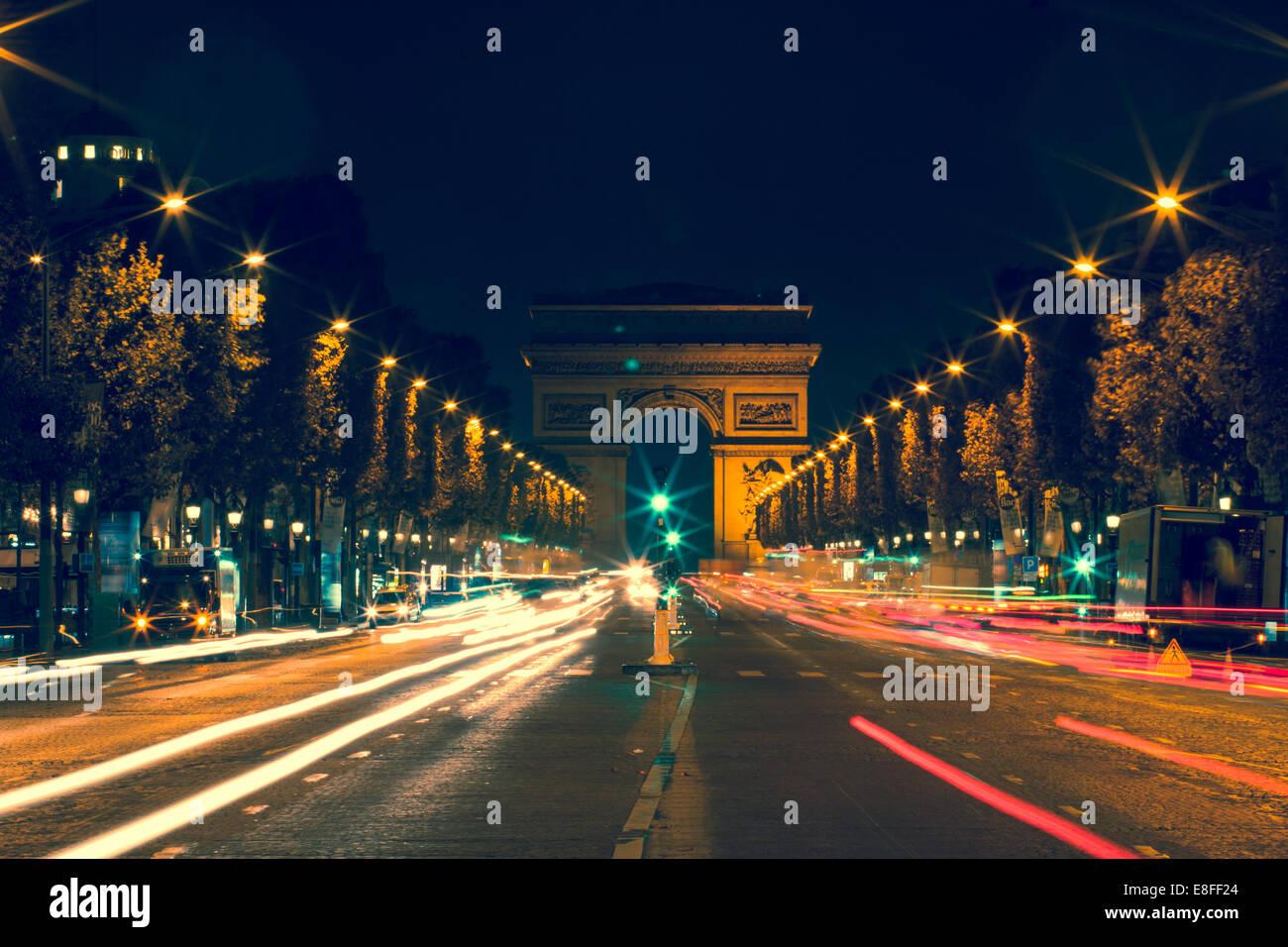 France, Paris, Avenue des Champs-Elyses at night - Stock Image