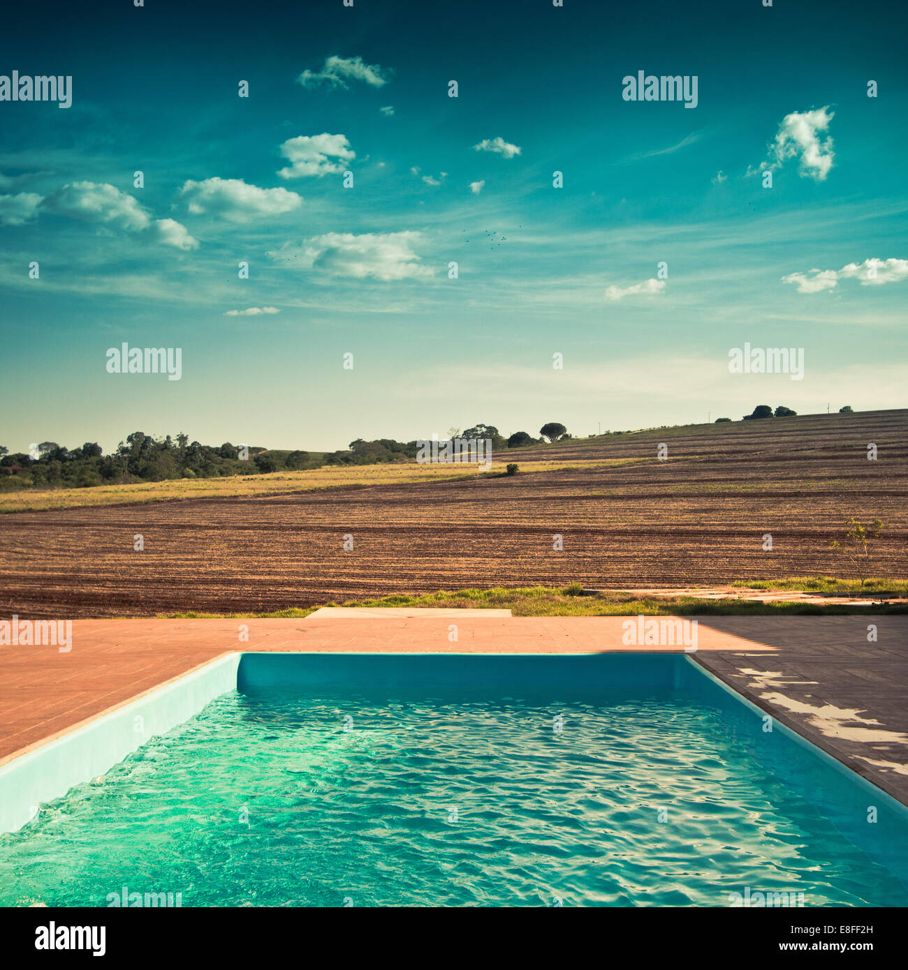 Outdoor pool and view over fields - Stock Image