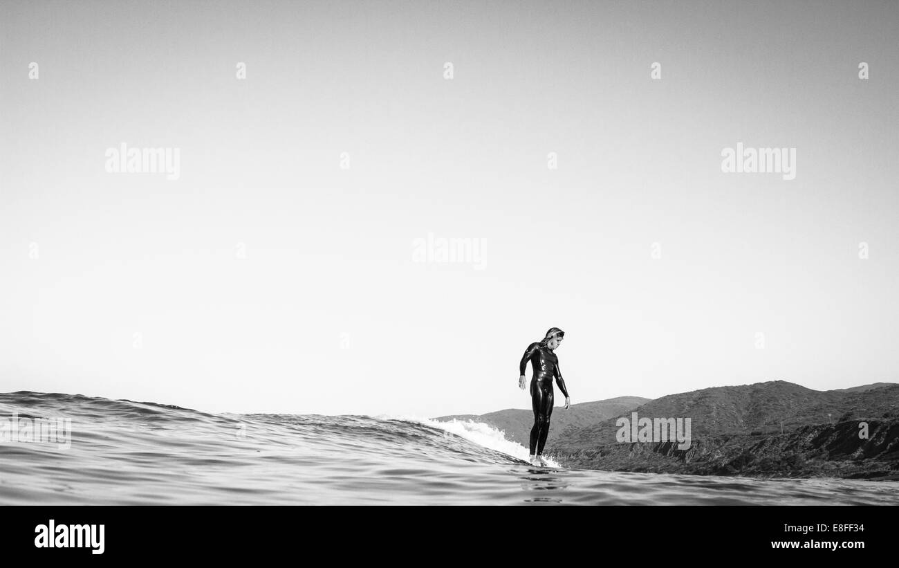 USA, California, Los Angeles County, Malibu, Surfer sliding on water Stock Photo