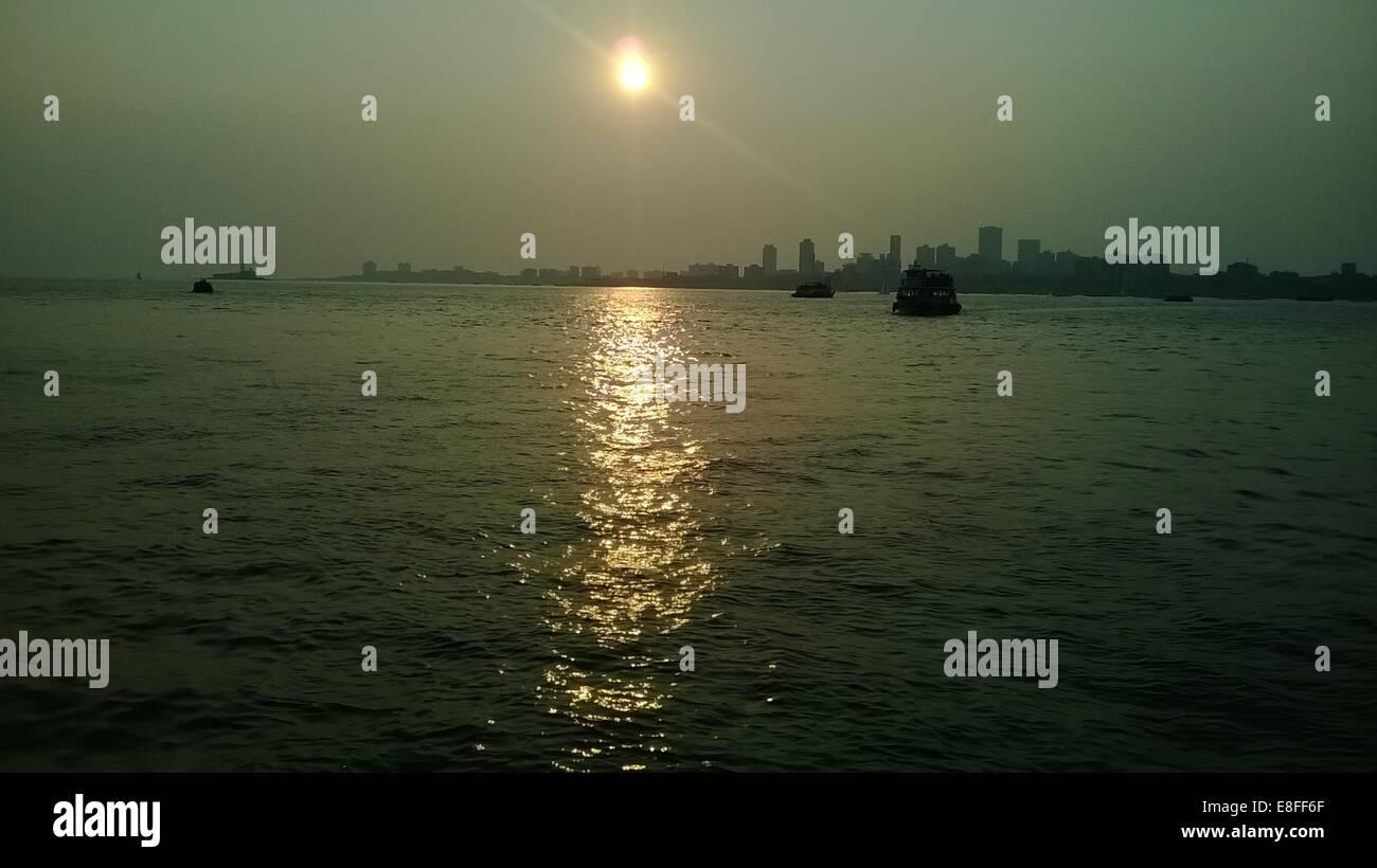 India, Maharashtra, Greater Bombay, Koli Nagar, Colaba, Sunset from Sea - Stock Image
