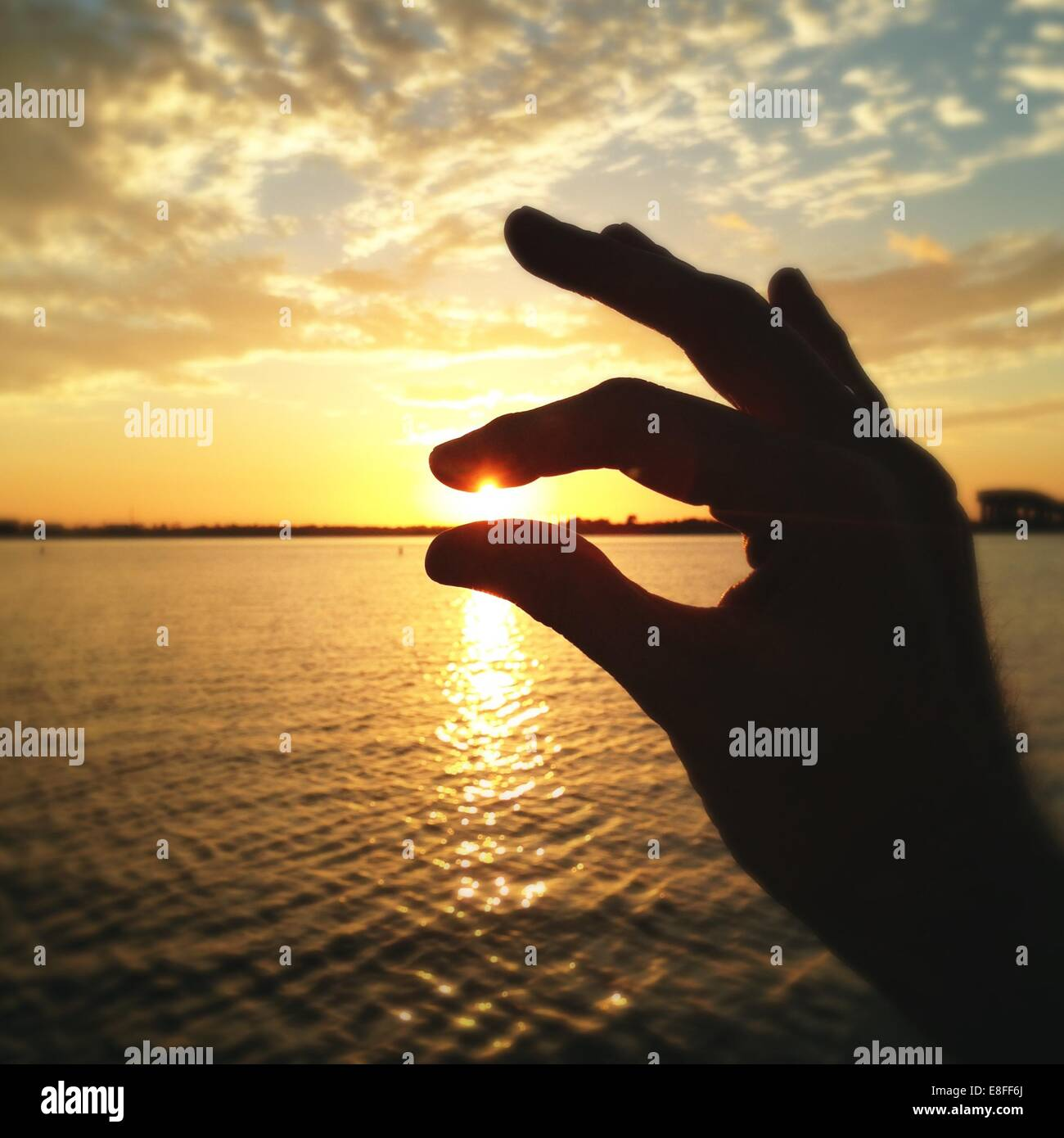 USA, Los Angeles, Prien Lake Park, Hand holding sun Stock Photo