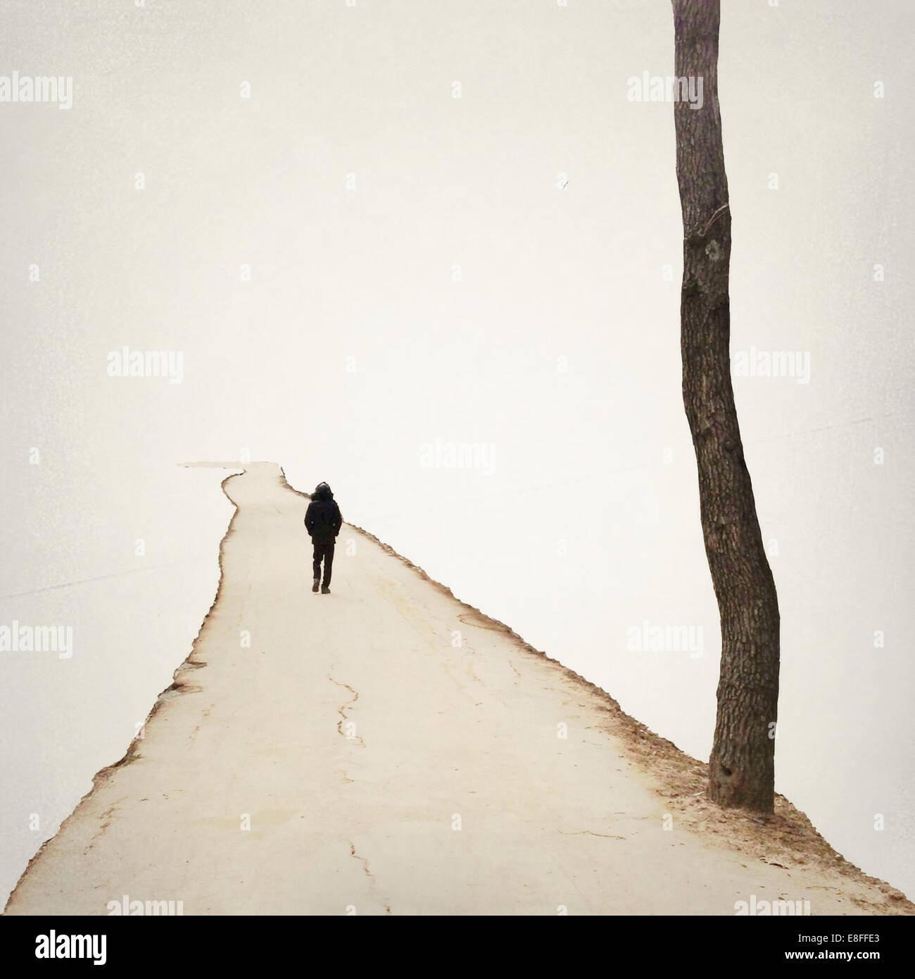Person walking along a footpath - Stock Image