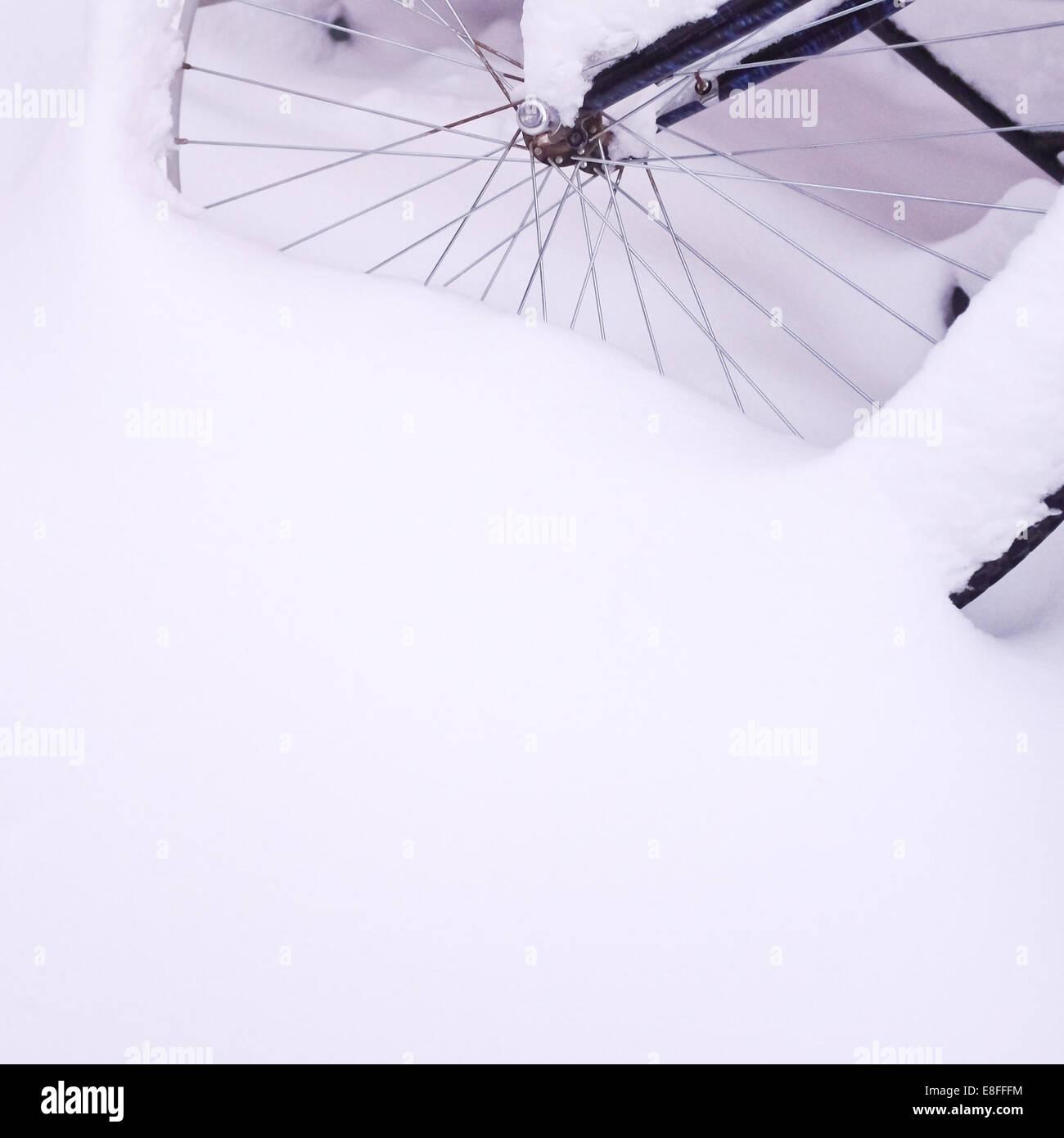 Bike wheel covered with fresh snow Stock Photo