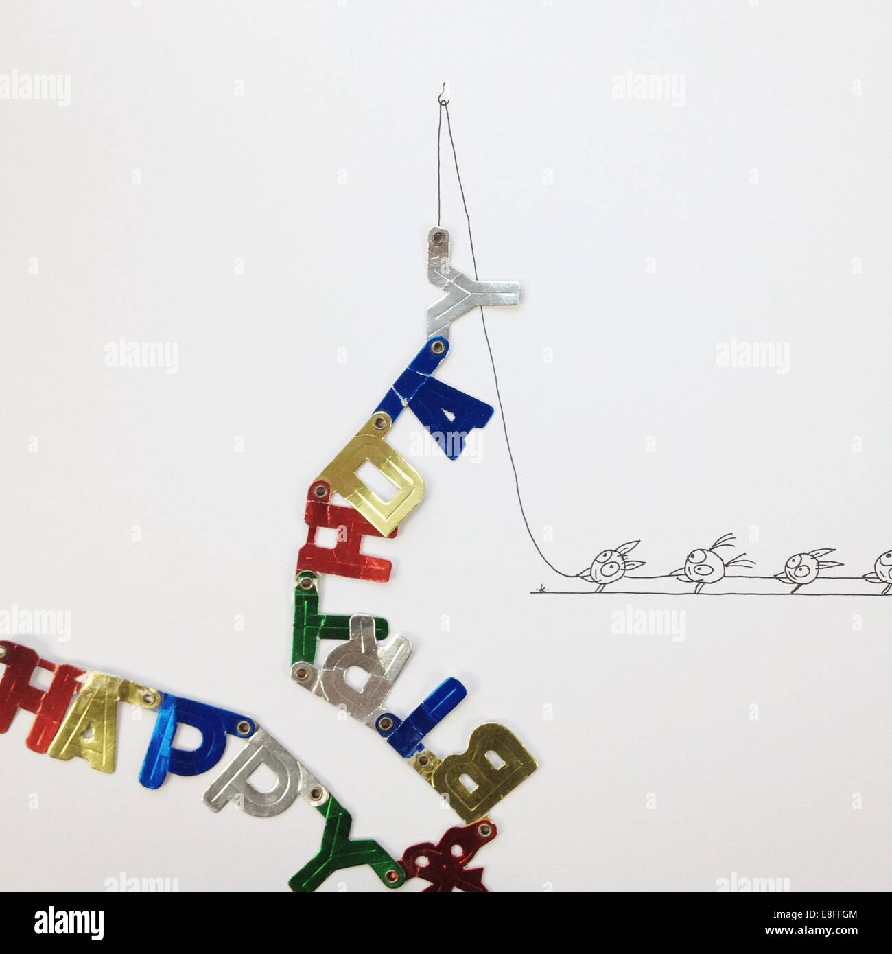 Conceptual fantasy characters pulling a happy birthday banner - Stock Image