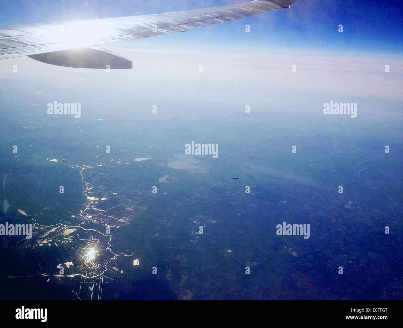 View of airplane wing from vehicle interior/airplane window - Stock Image