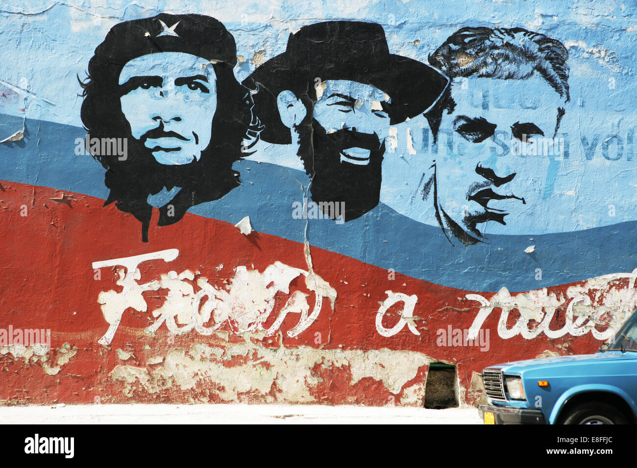 Cuba, Havana, Car parked in front of mural - Stock Image