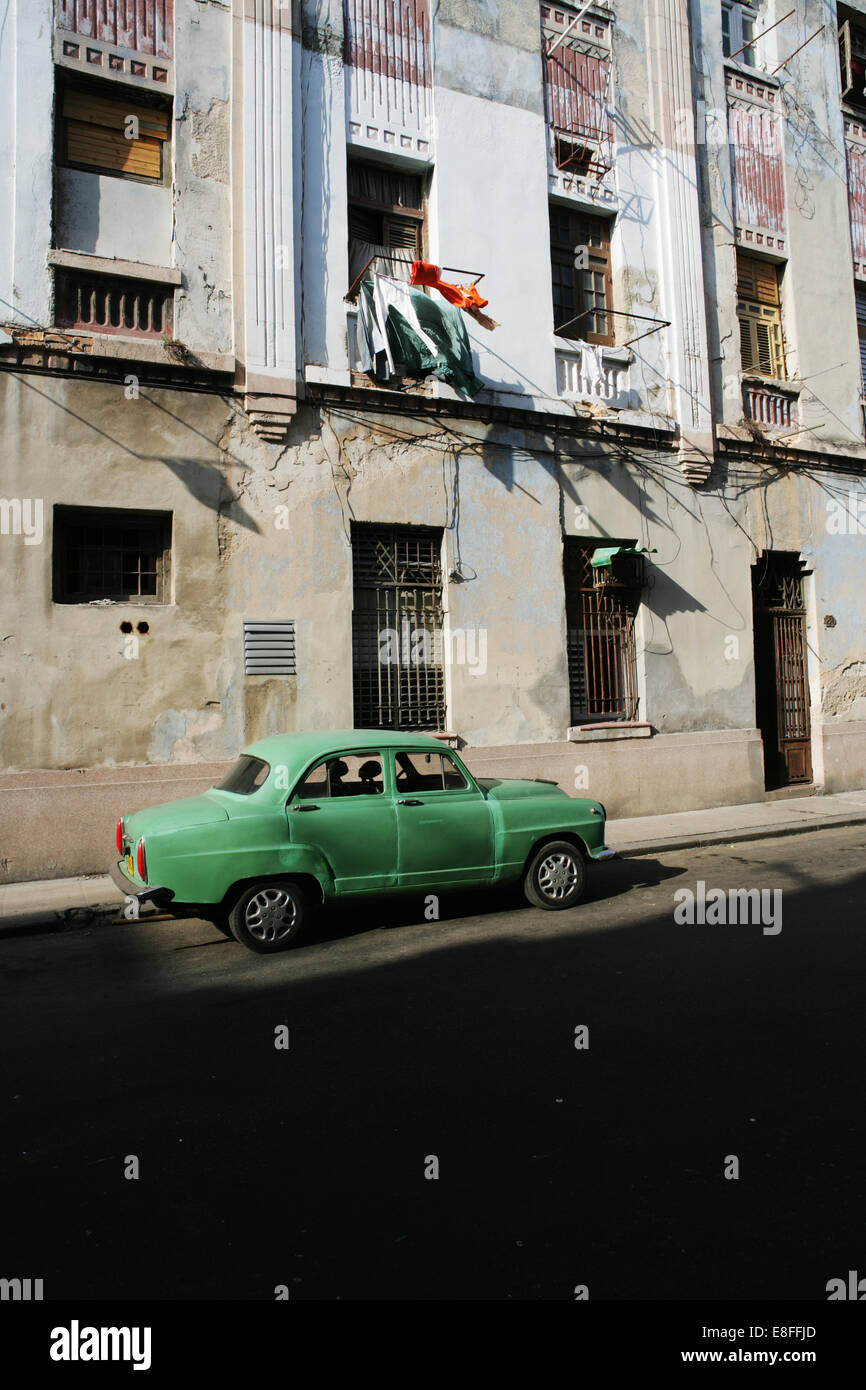 Cuba, Havana, Old car parked on street - Stock Image