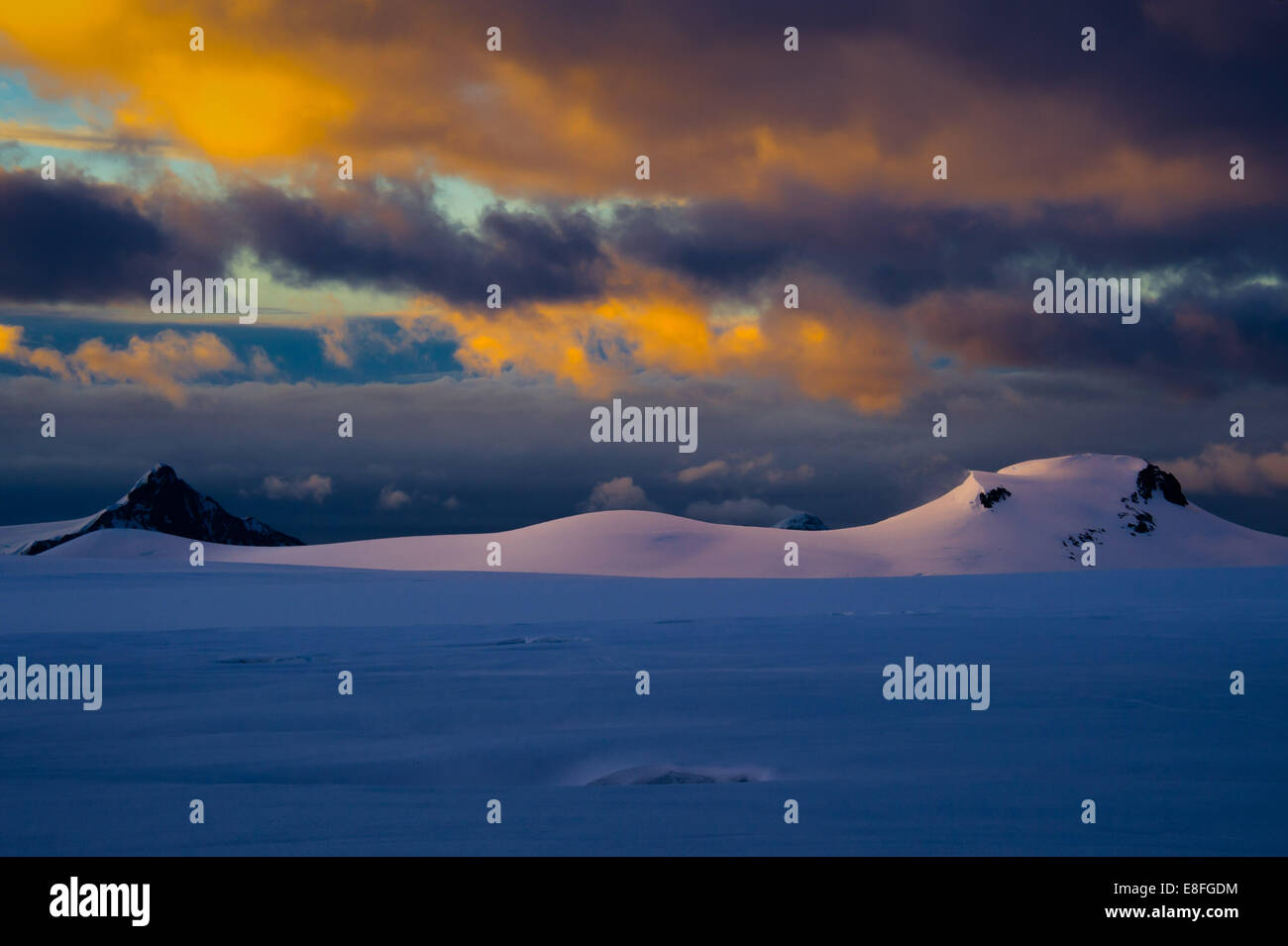 Clouds over snowy mountains - Stock Image