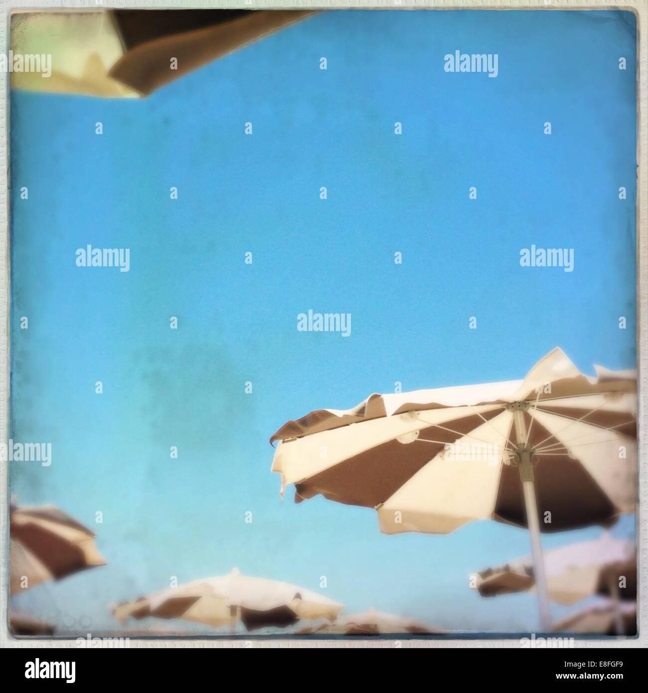 Blue sky at beach and beach umbrellas - Stock Image