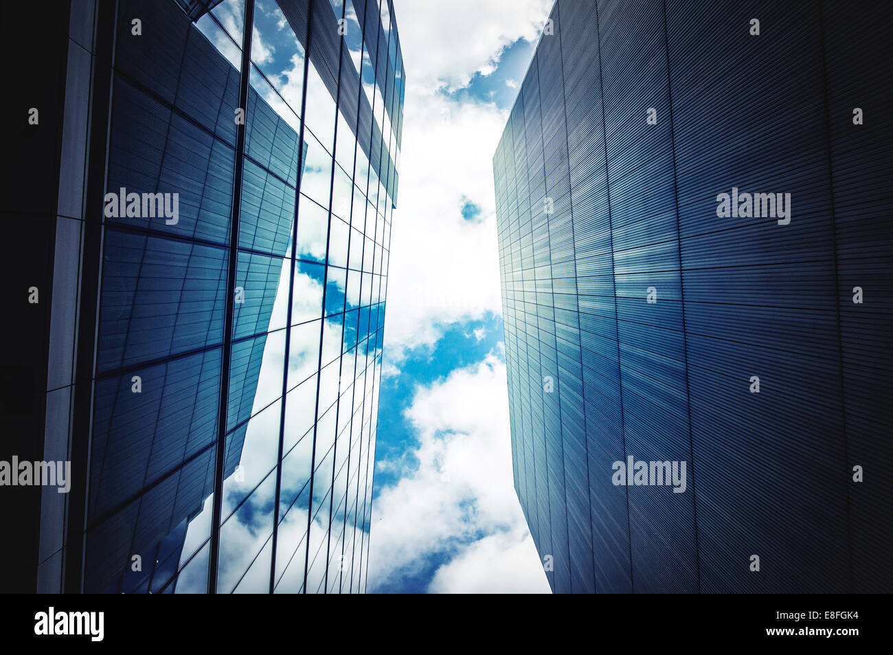 Office buildings with sky and clouds - Stock Image