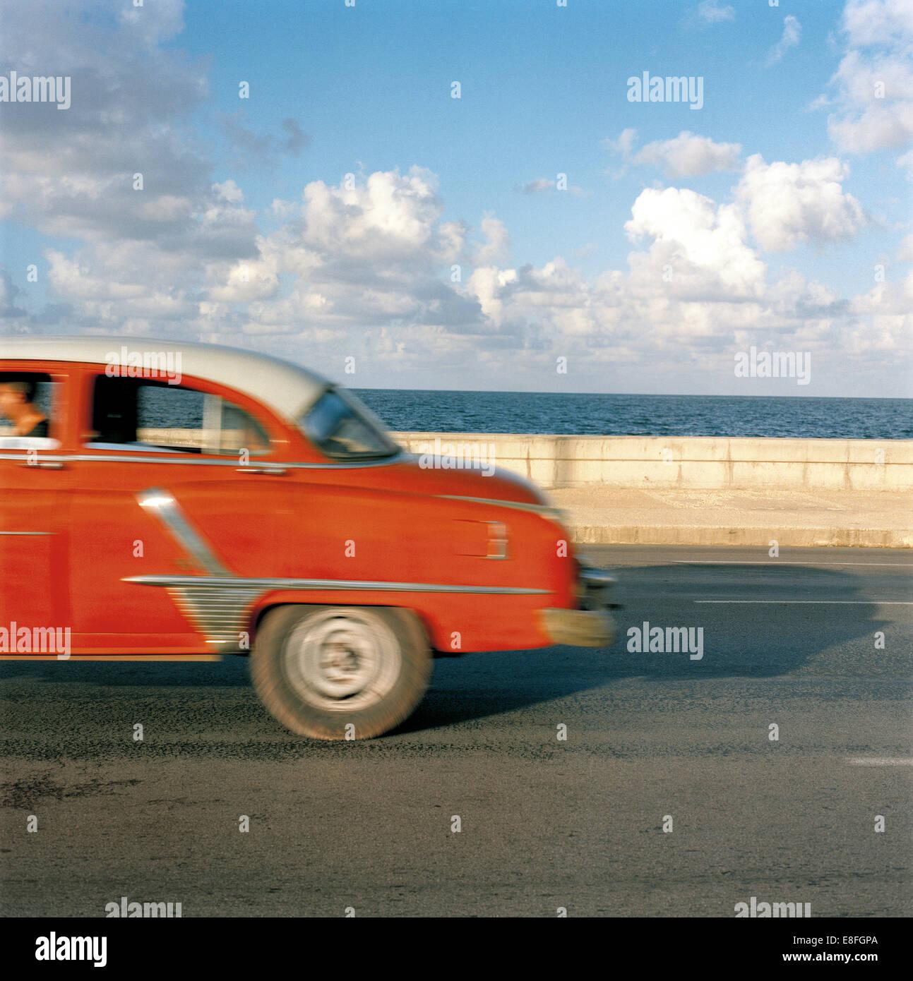 Vintage car driving along Malecon, Havana, Cuba - Stock Image