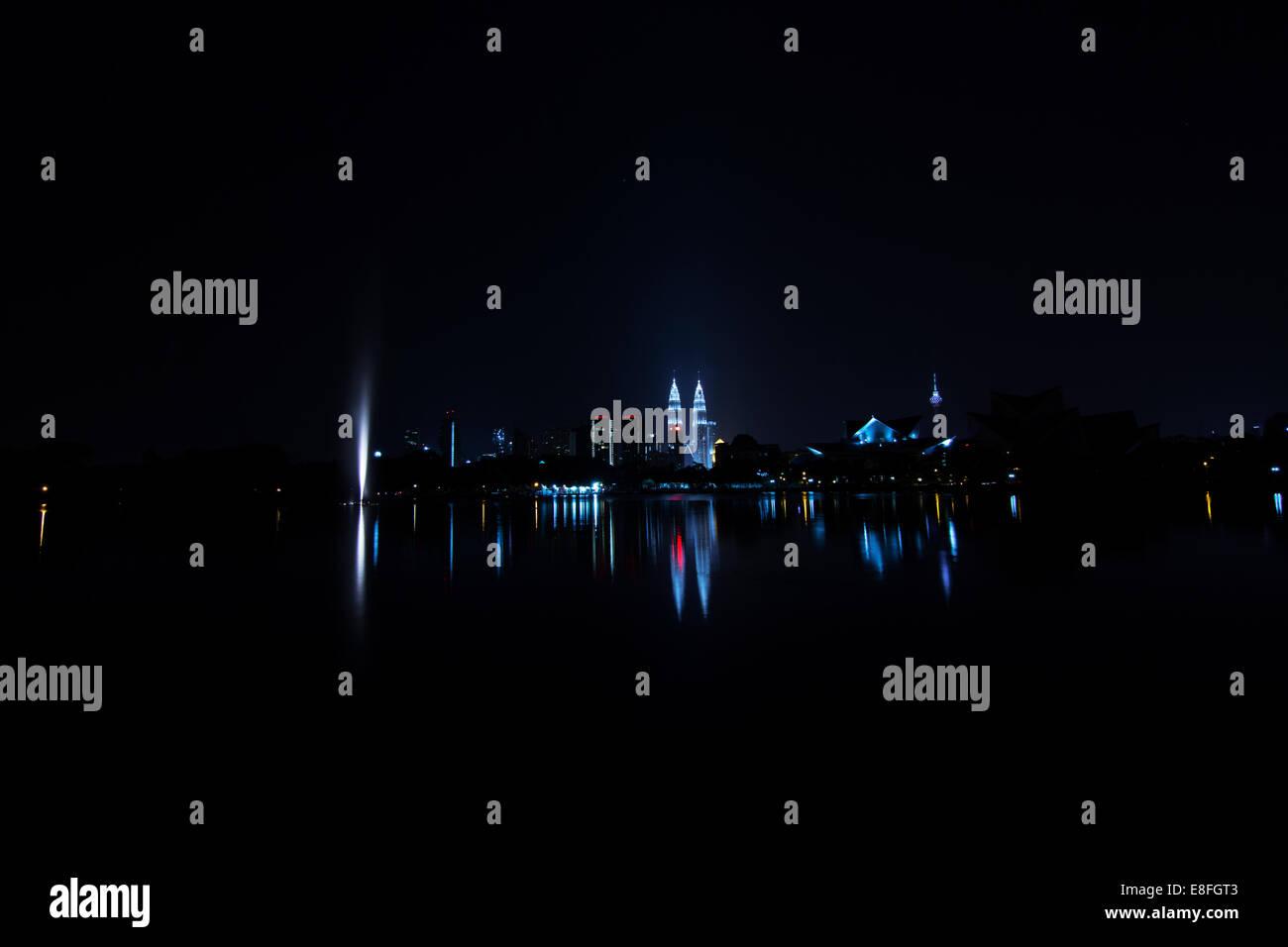 Malaysia, Kuala Lumpur, City skyline at night - Stock Image
