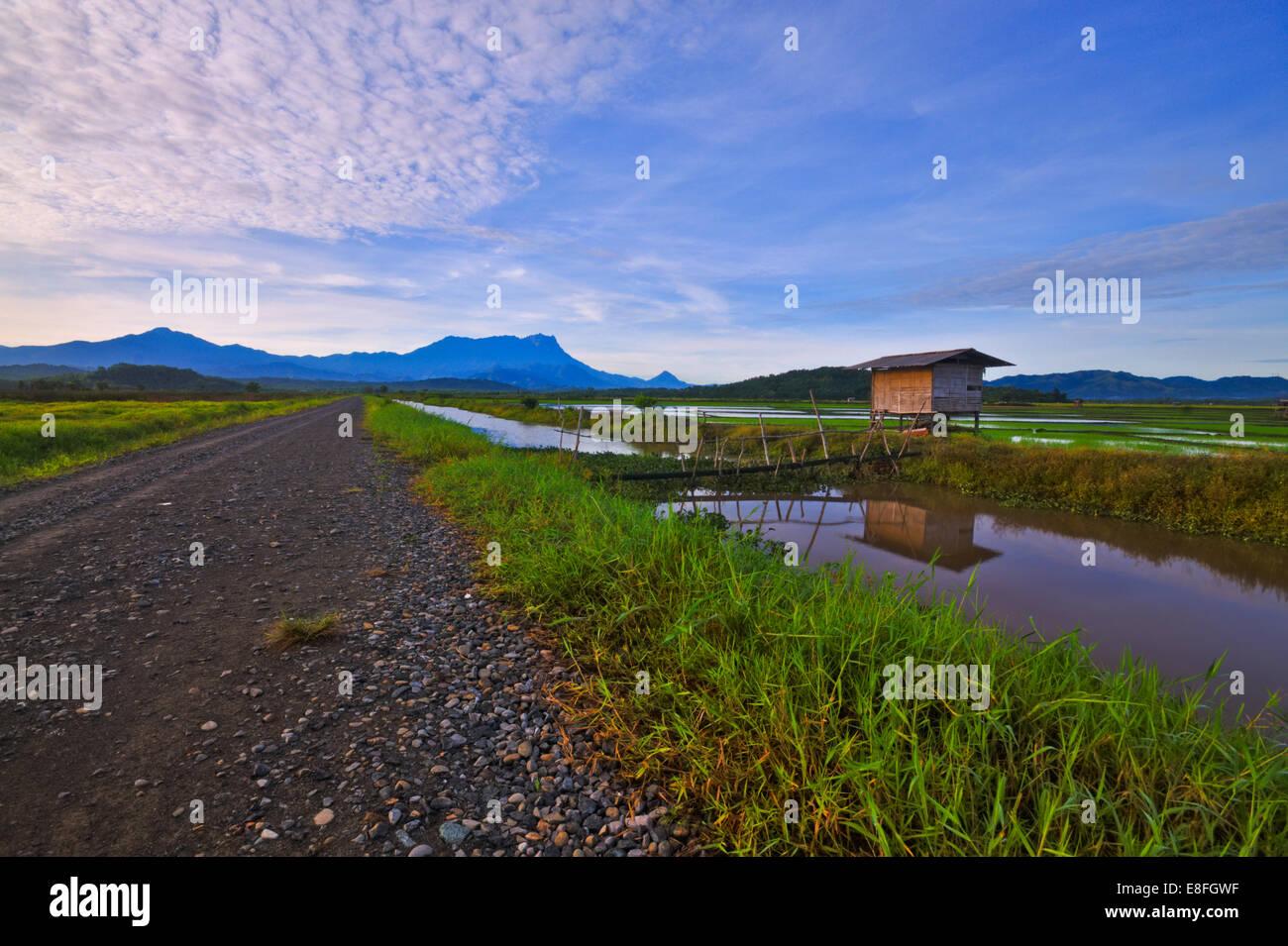 Malaysia, Sabah, Kota Belud, Sunrise over Sangkir Village - Stock Image