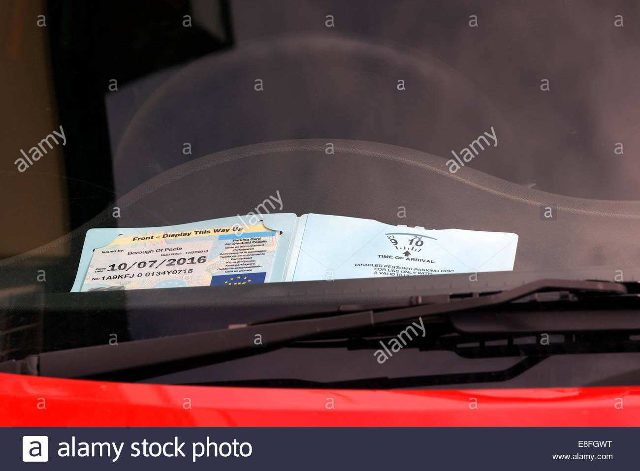 Disability Blue badge and parking clock, on car dashboard, Poole, Dorset, England UK - Stock Image