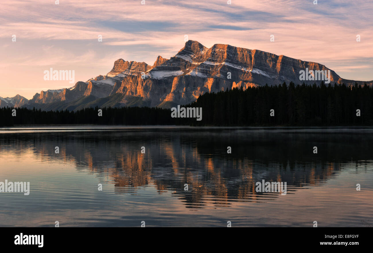 Mount Rudle reflected in Two Jack Lake, Banff National Park, Alberta, Canada - Stock Image