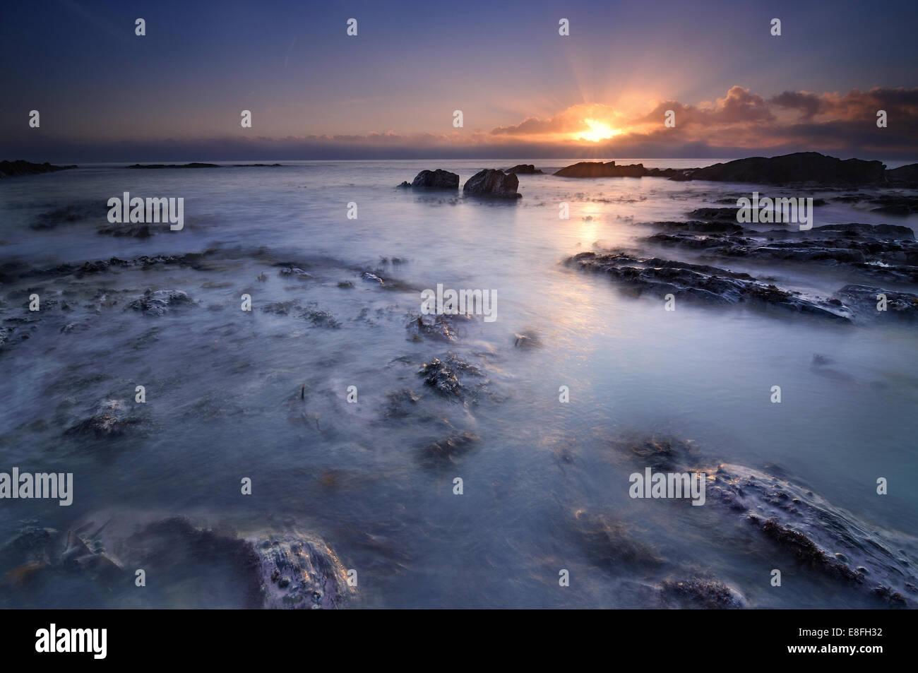Finland, Pirkanmaa, Tampere, Sunrise over ocean - Stock Image