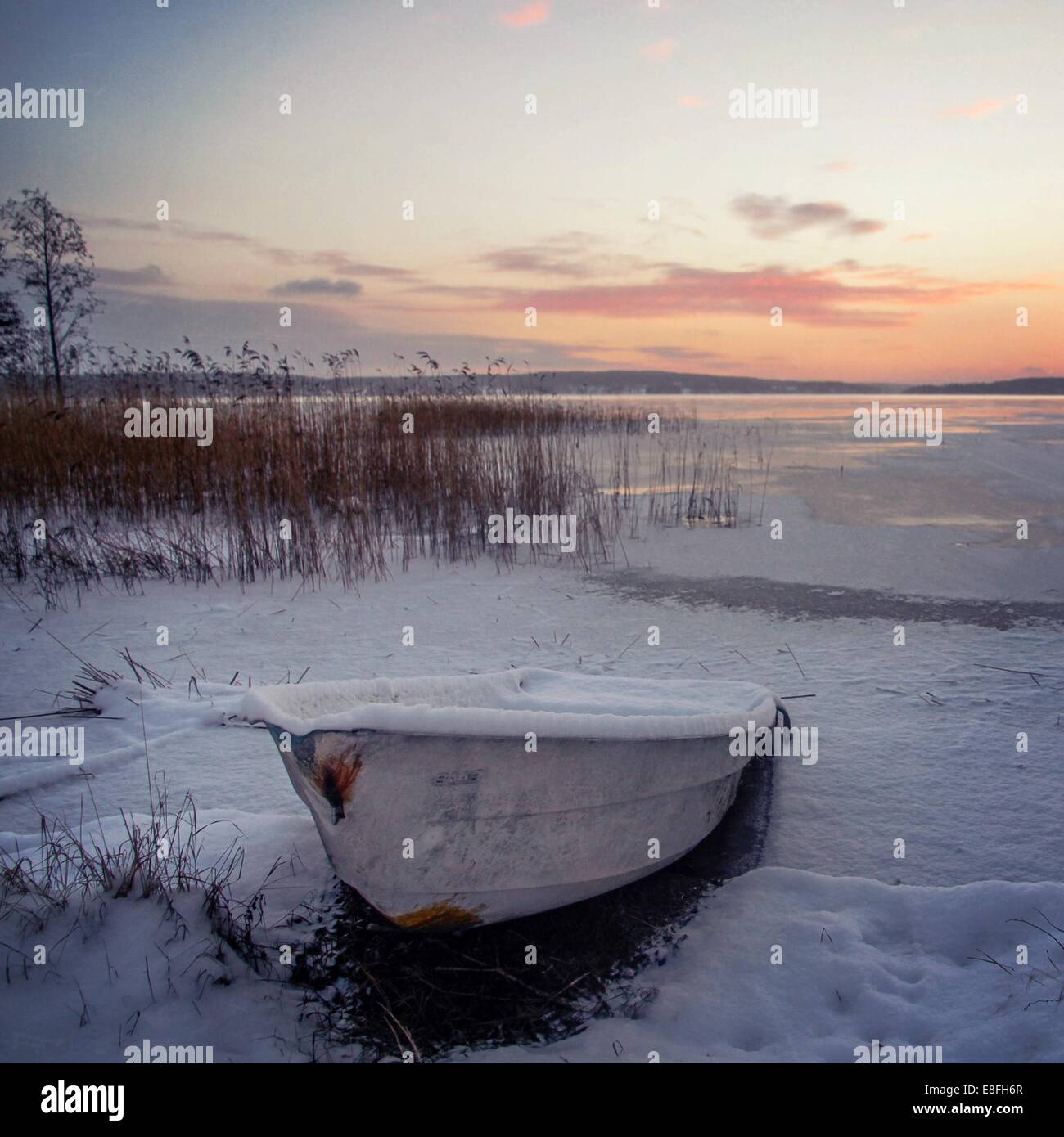 Snow covered rowing boat - Stock Image