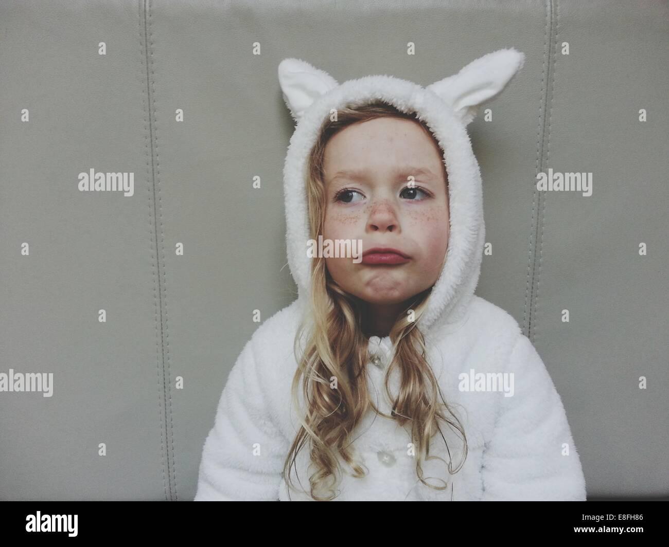 Girl in bunny rabbit costume - Stock Image