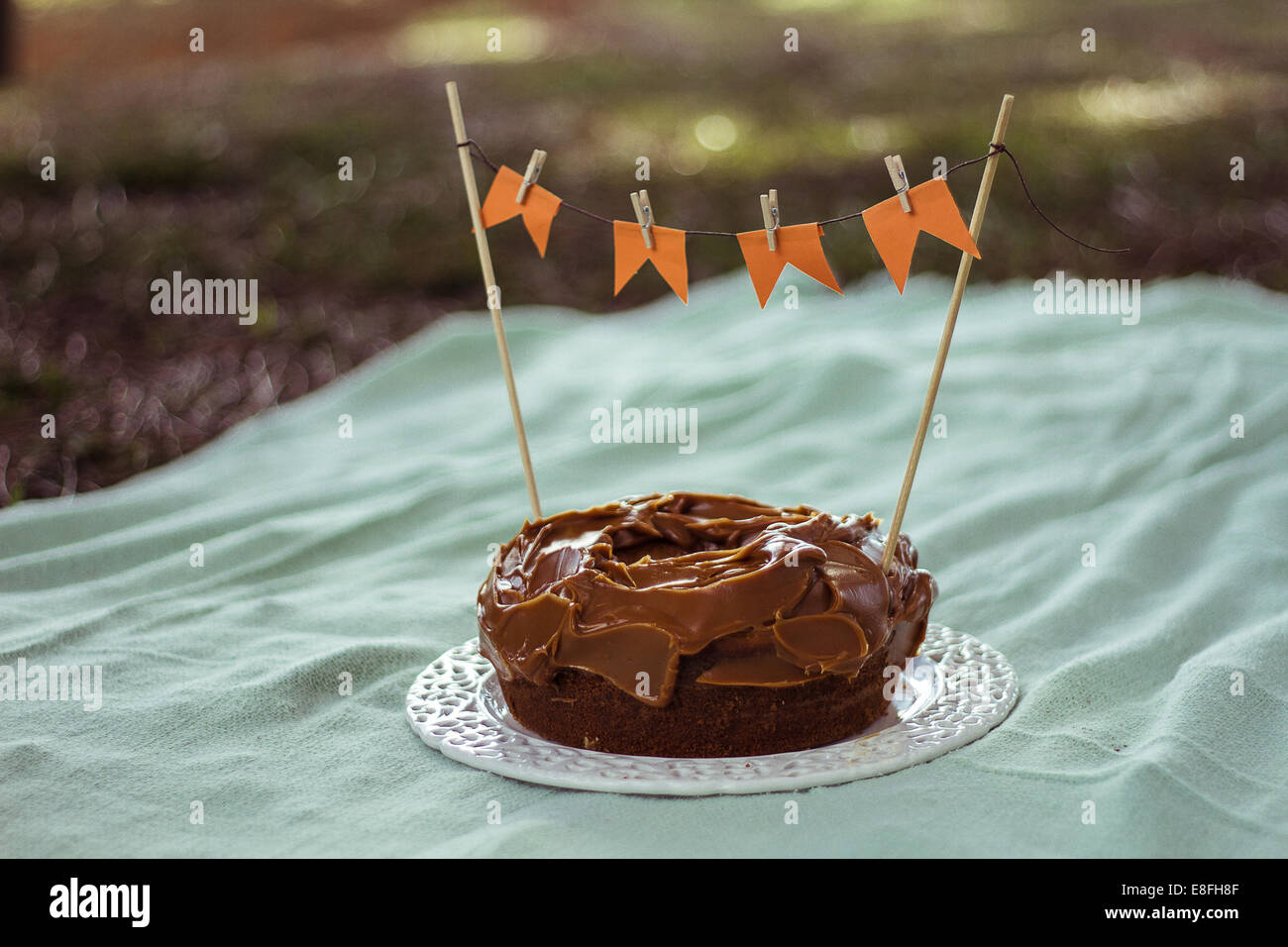 Birthday Cake decorated with flags - Stock Image