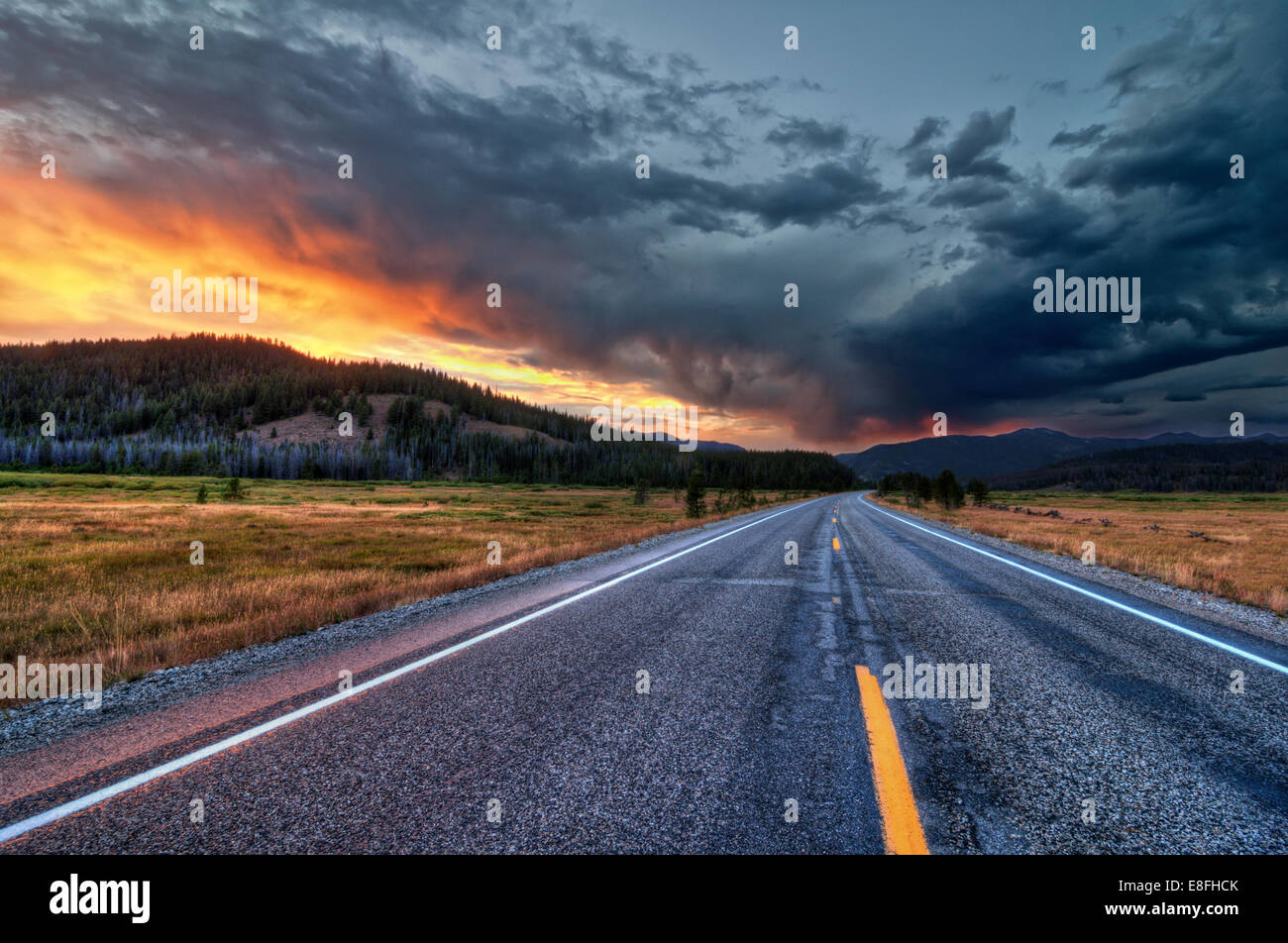 Straight road at sunset - Stock Image