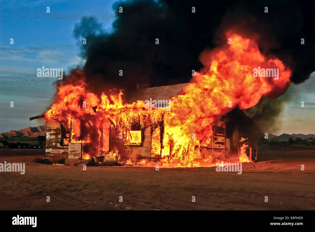 Abandoned house on fire, Gila Bend, Arizona, America, USA - Stock Image