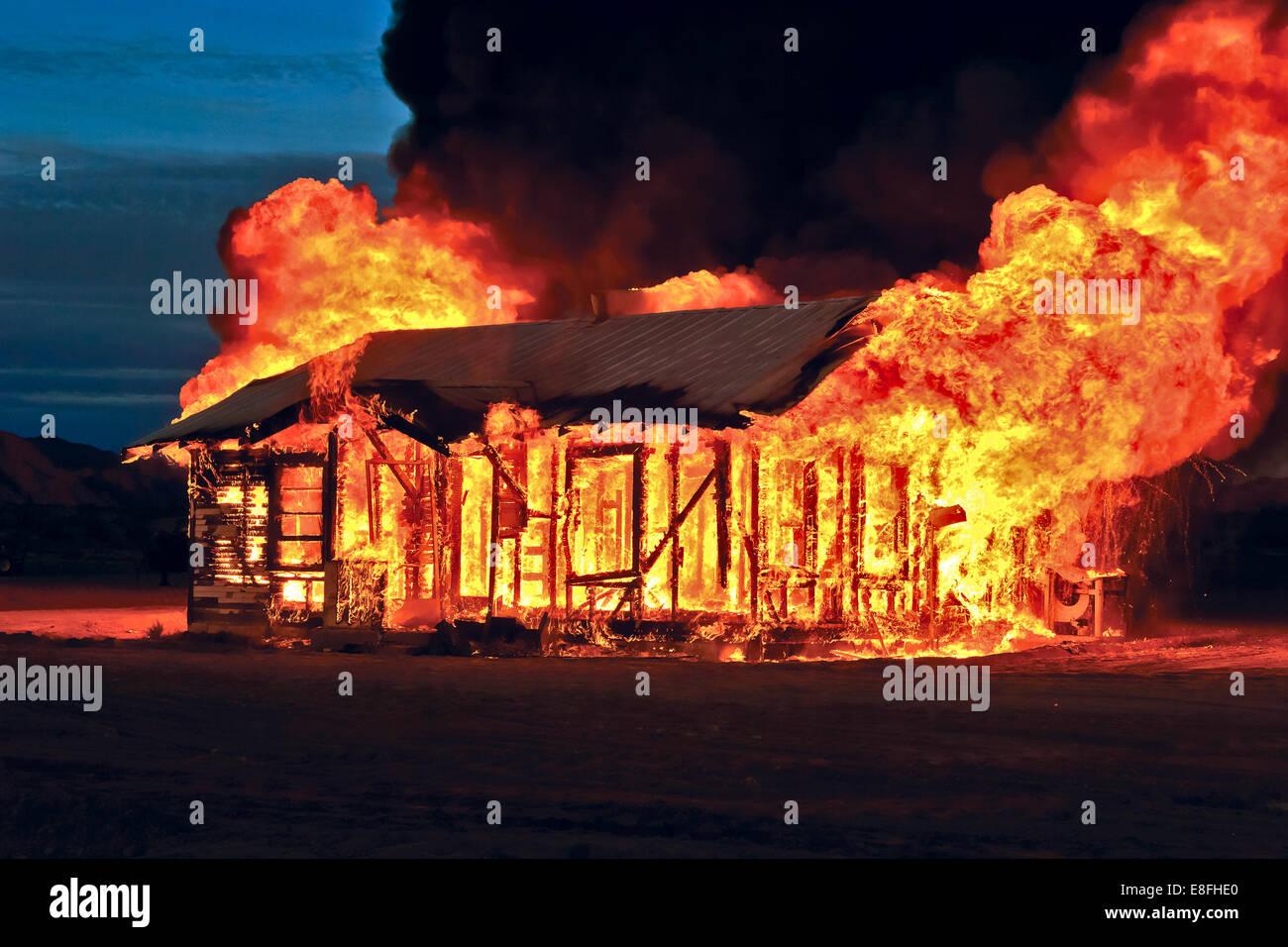 Abandoned house on fire, Gila Bend, Arizona, America, USA - Stock Image
