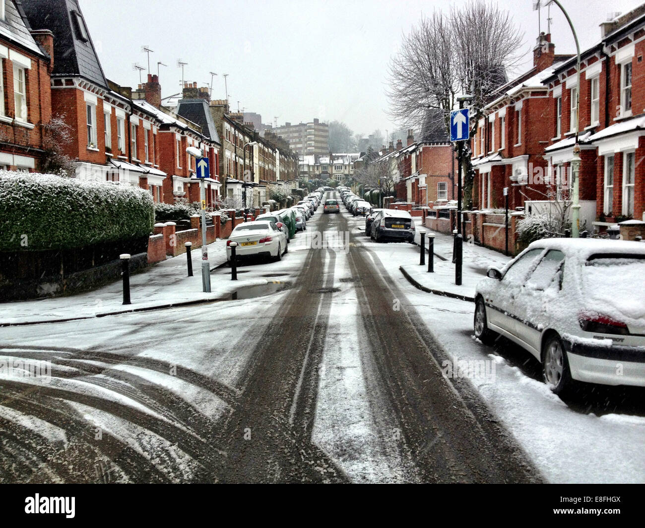 UK, London, London Borough of Haringey, Highgate Village, Urban street covered in snow Stock Photo