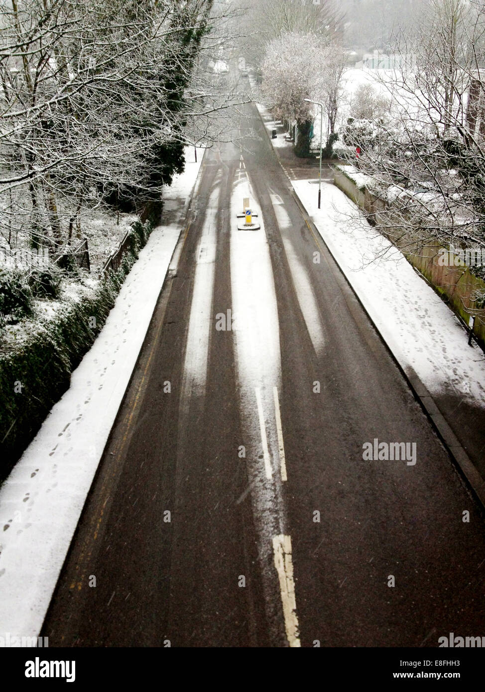 UK, London, London Borough of Haringey, Crouch End, Road covered in snow - Stock Image