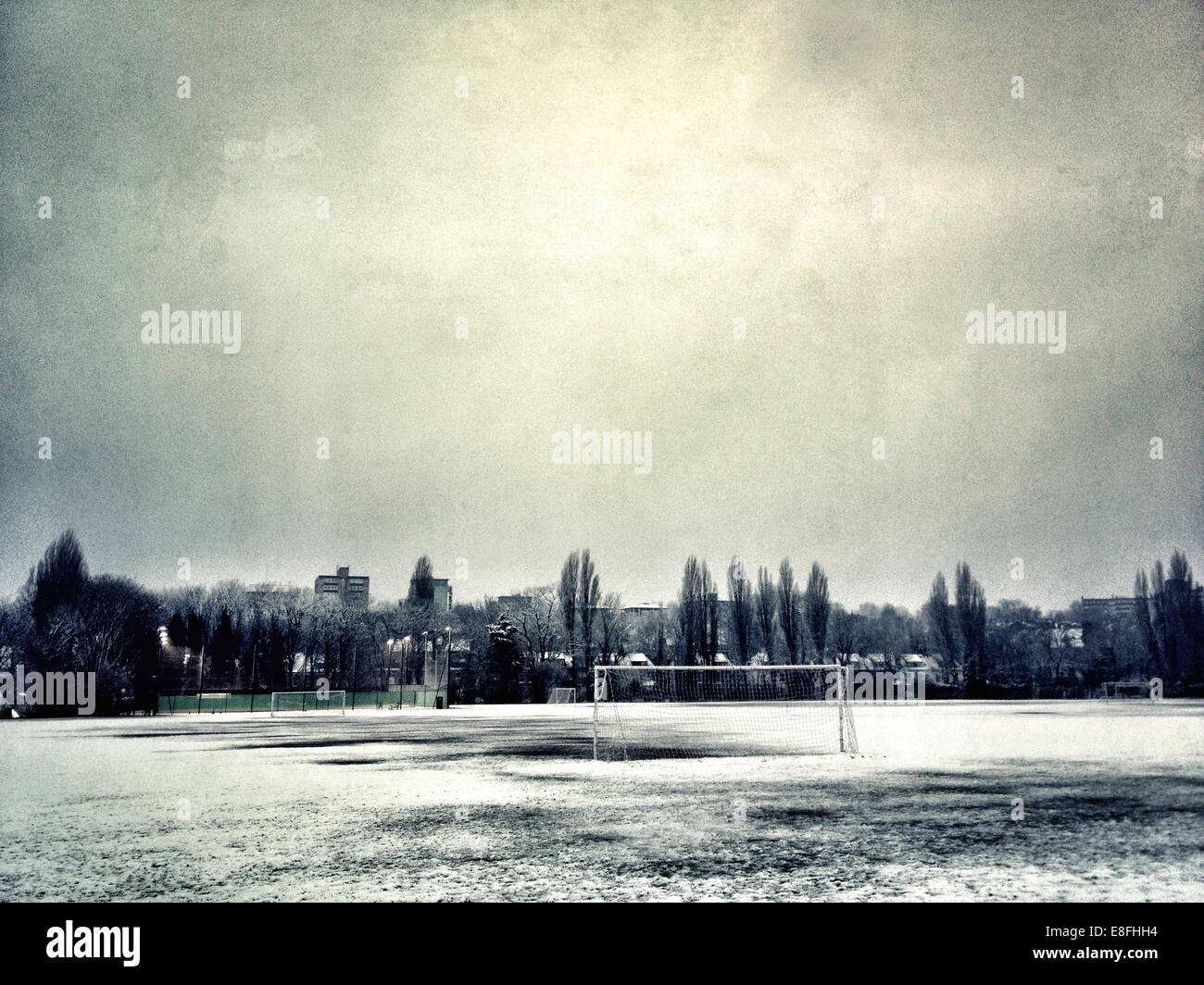 UK, London, London Borough of Haringey, Crouch End, Snow covered football pitch - Stock Image
