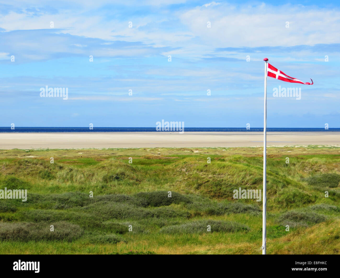 Denmark, Beach with Danish flag - Stock Image