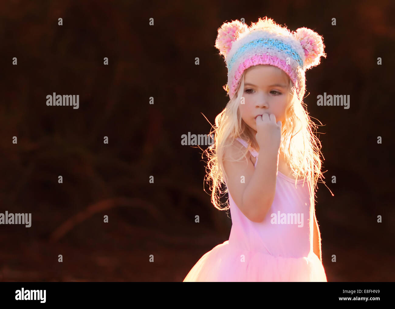 Little girl (4-5) wearing hat with bear ears - Stock Image