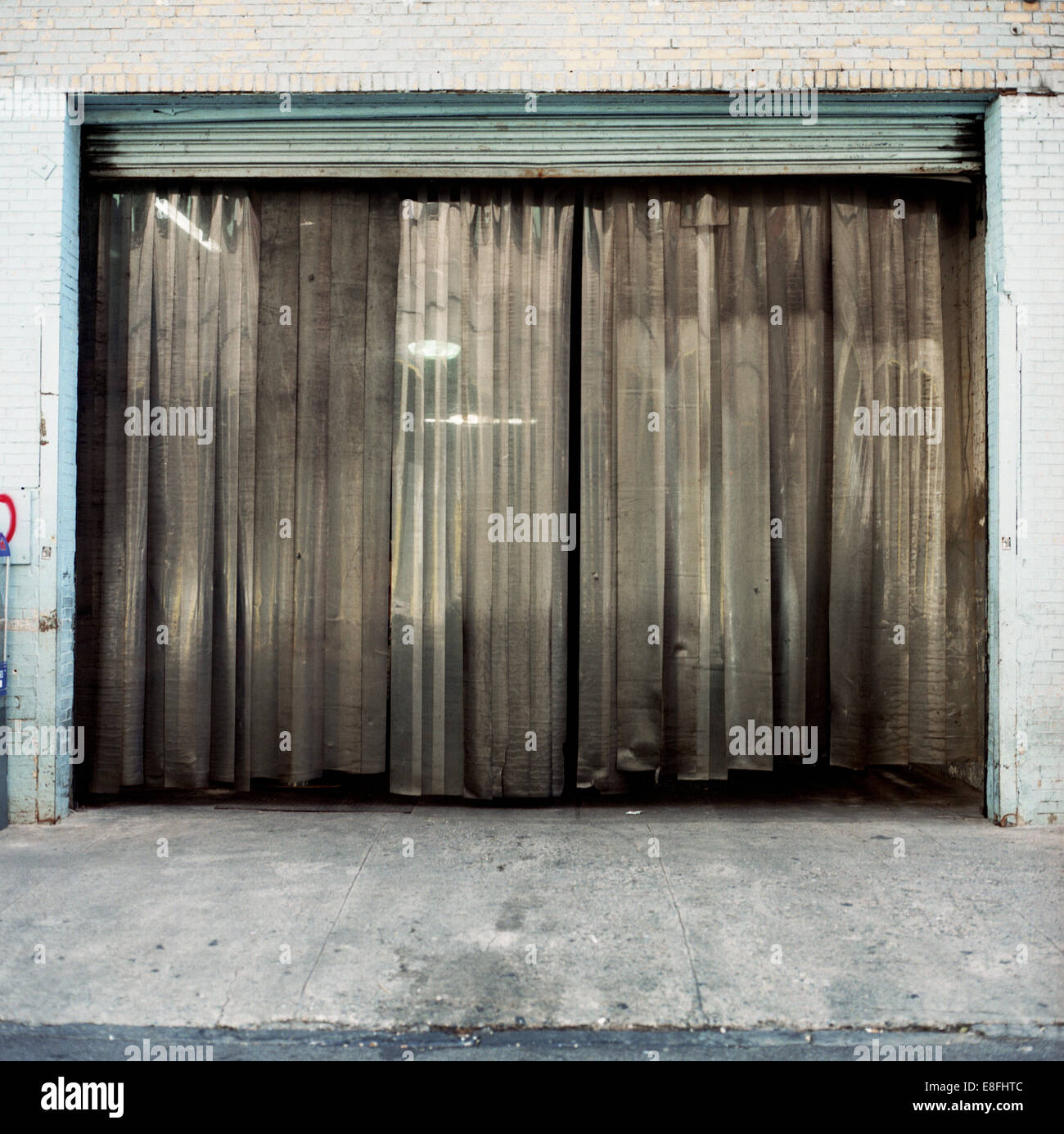 USA, New York State, New York City, Curtain in garage door Stock Photo
