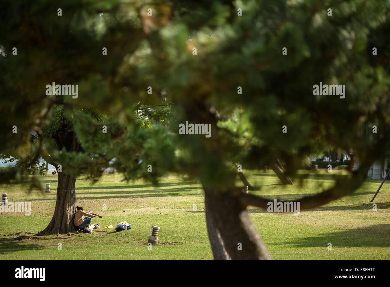 Japan, Kanagawa, Yokohama, Nishi ward, Picnic in park Stock Photo